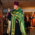 "Father John Maxwell spreads incense during the Nov. 10 ""Visitors' Vespers"" service at St. John of Ch..."