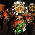 Santiago Rodriguez, (above) 17, walks with his sousaphone lit with lights down the parade route Frid...