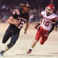 Austin Easterling, left, of Pea Ridge, runs past Heber Springs defensive back Micah Dew on Friday at...
