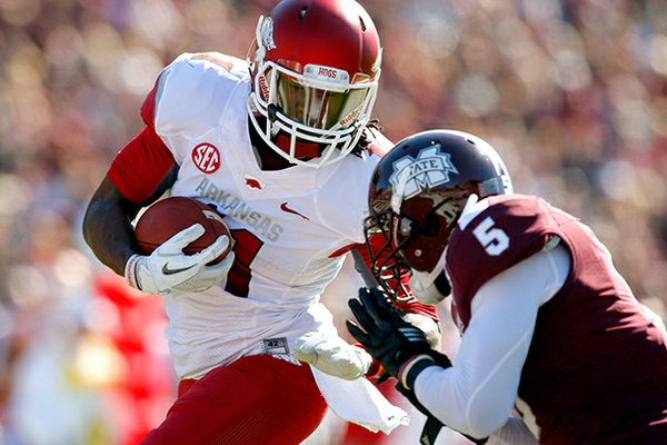 NWA Media/JASON IVESTER -- Arkansas senior wide receiver Cobi Hamilton is hit by Mississippi State junior Nicoe Whitley after making a touchdown catch during the first quarter on Saturday, Nov. 17, 2012, at Davis Wade Stadium in Starkville, Miss.