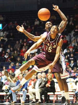 UALR's Stetson Billings and Mississippi's Murphy Holloway go for the ball during Friday night's game in Oxford, Miss.