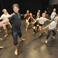 Choreographer and dancer Bill Hastings, left, leads a group of students Oct. 14 through a series of ...