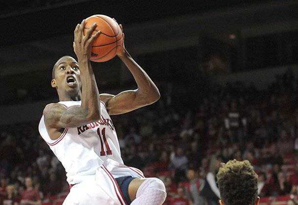 nwa-mediaandy-shupe-arkansas-sophomore-guard-bj-young-11-floats-to-the-goal-on-sunday-nov-18-2012-during-the-first-half-of-play-in-bud-walton-arena