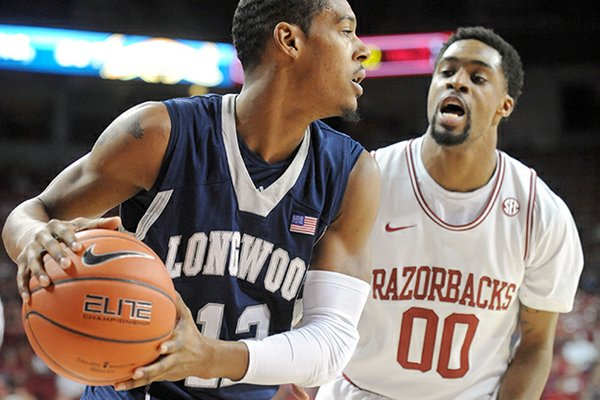 NWA Media/ANDY SHUPE -- Arkansas sophomore guard Rashad Madden (00) pressures Longwood junior guard Tristan Carey after the ball was inbounded Sunday, Nov. 18, 2012, during the first half of play in Bud Walton Arena.