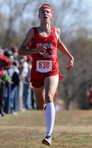 Grant Williams, a cross-country all-star representing the state of Arkansas, finishes first Saturday at Rogers High during the Arkansas-Oklahoma All-Star Cross Country Challenge. Williams won the race with a time of 16:11.36.