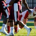 NWA Media/JASON IVESTER -- Arkansas senior quarterback Tyler Wilson gets up from the field after bei...