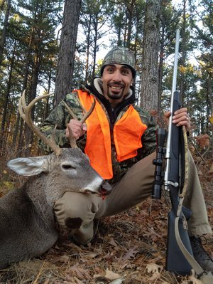 Basel Khalil of North Little Rock bagged this 8-point buck last week during his first deer hunt in the Ozark National Forest.