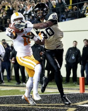 Vanderbilt wide receiver Chris Boyd (80) catches an 11-yard touchdown pass in front of Tennessee defensive back Marsalis Teague (10) during the second quarter of the Commodores' 41-18 victory over the Volunteers on Saturday in Nashville, Tenn.