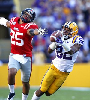 LSU wide receiver James Wright (82) pulls in a 48-yard reception in front of Mississippi defensive back Cody Prewitt (25) during the first half of the No. 7 Tigers' 41-35 victory over the Rebels on Saturday in Baton Rouge.