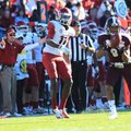Arkansas Coach John L. Smith (left) reacts as Mississippi State's Darius Slay (9) intercepts a fourt...