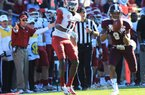 Arkansas Coach John L. Smith (left) reacts as Mississippi State's Darius Slay (9) intercepts a fourth-quarter pass from Tyler Wilson intended for Cobi Hamilton (11). Slay's 15-yard return was nullified by a Mississippi State personal foul, but Nick Griffin scored on a 60-yard run on the next play, giving the Bulldogs a 45-14 lead.