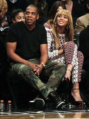 Having rapper Jay-Z (left) as a partial owner is one of several things that has created a buzz around the recently relocated Brooklyn Nets. According to one website, the team's choice of a mascot also has created a buzz, but in a negative way.