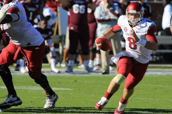 Arkansas senior quarterback Tyler Wilson (right) came into Saturday's game with a more established reputation than Mississippi State counterpart Tyler Russell, but Russell had the edge Saturday in the Bulldogs' 45-14 victory, throwing for more yards and touchdowns.