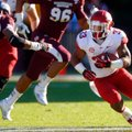 Arkansas senior running back Dennis Johnson looks for running room against Mississippi State during ...
