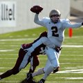 Matt Simpson, former Shiloh Christian quarterback, looks for a receiver in the 3A State Championship...