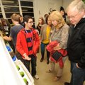Daniel Carmona, a Fayetteville High School junior, left, explains a bucket garden system Nov. 8 to v...