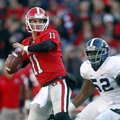Georgia quarterback Aaron Murray (11) throws under pressure from Georgia Southern defensive end Javo...