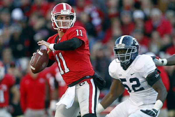 Georgia quarterback Aaron Murray (11) throws under pressure from Georgia Southern defensive end Javon Mention (52) in the second half of an NCAA college football game on Saturday, Nov. 17, 2012, in Athens, Ga. (AP Photo/John Bazemore)