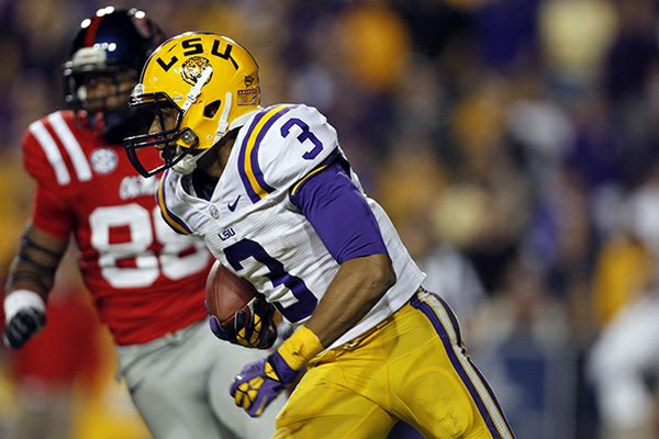 LSU wide receiver Odell Beckham (3) returns a punt 89 yards for a touchdown in the second half of their NCAA college football game against Mississippi in Baton Rouge, La., Saturday, Nov. 17, 2012. LSU won 41-35. (AP Photo/Gerald Herbert)