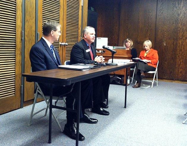 arkansas-department-of-education-commissioner-tom-kimbrell-at-the-microphone-and-greg-murry-the-conway-school-district-superintendent-release-monday-nov-19-2012-the-2012-school-accountability-reports