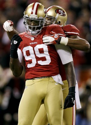 San Francisco 49ers defensive end Aldon Smith (99) had plenty of chances to celebrate Monday, finishing with 5 1/2 sacks of Chicago Bears fill-in quarterback Jason Campbell, as the 49ers defense held the Bears to 143 offensive yards and one touchdown. Campbell threw for 107 yards and was intercepted twice.