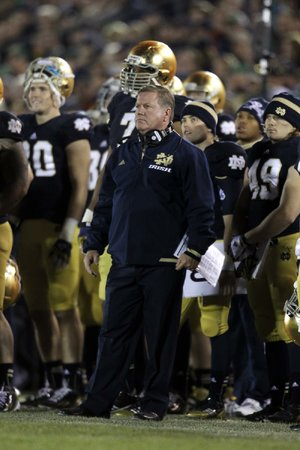 Notre Dame Coach Brian Kelly gave the Fighting Irish their only No. 1 vote in the coaches' poll last week. He wasn't the only one Sunday, as the Irish moved from No. 3 to No. 1 in the Bowl Championship Series rankings.