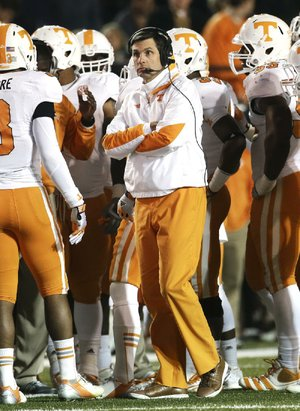 Derek Dooley (center) was fired as Tennessee's head football coach with one game remaining in his third season. Dooley (15-21) never had a winning season, going 6-7, 5-7 and 4-7. Offensive coordinator Jim Chaney will coach the Volunteers in their final regular-season game Saturday against Kentucky.