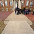 Visitors look at names on the Senior Walk in front of Old Main on the University of Arkansas campus ...