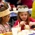 Maddie Keller, (above) left, and Sophia Scamardo sample the food during the First Thanksgiving meal ...