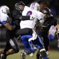 John Donald, Bentonville linebacker, sacks Kody Frasure, West Memphis quarterback, Friday during the...