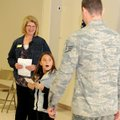 Destiny Adams, 9, fourth-grader at West Fork Elementary School, is surprised as her brother, Staff S...