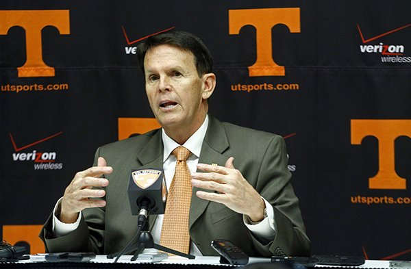 Tennessee athletic director Dave Hart speaks to reporters at a news conference on Sunday, Nov. 18, 2012, in Knoxville, Tenn., after it was announced that head football coach Derek Dooley would be replaced by offensive coordinator Jim Chaney for the final SEC regular season game against Kentucky. (AP Photo/Wade Payne)