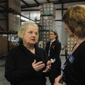 Marge Wolf, (right) left, president and CEO of the Northwest Arkansas Food Bank, talks with Gaye Wil...