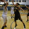 Prairie Grove's Whitnee Fitts, right, defends Shiloh Christian's Cayden Sears during Tuesday night's...