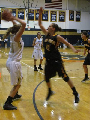 Prairie Grove's Whitnee Fitts, right, defends Shiloh Christian's Cayden Sears during Tuesday night's nonconference game.