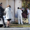 Benton County Coroner's office employees prepare to remove the body of a 6-year-old girl Tuesday nea...