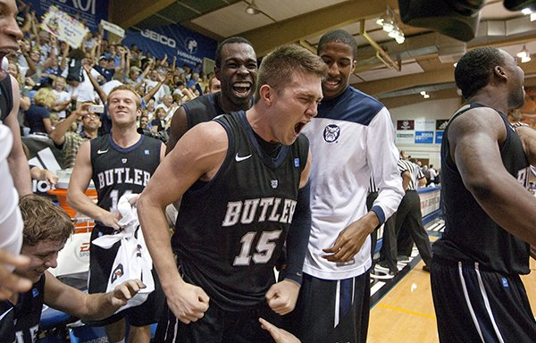 Butler guard Rotnei Clarke (15) and his teammates celebrates Clarke's 3-point shot in the second half of an NCAA college basketball game Monday, Nov. 19, 2012, in Lahaina, Hawaii. Clarke's last-second 3-pointer gave Butler a 72-71 win. (AP Photo/Eugene Tanner)