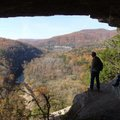 Roger Byrd of Siloam Springs, left, enjoys the view from the Goat Trail with fellow hikers.
