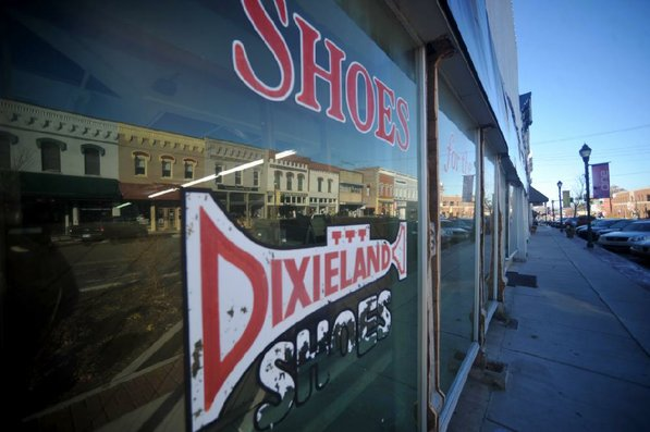 Photo by Michael Woods—                                                                                        The old Dixieland shoe store on the corner of Walnut and 1st street in Rogers Wednesday morning.  John Mack, owner of JKJ Architects, recently purchase the former Dixieland Shoe store on the corner of First and Walnut street. He is restoring the building which includes the Opera House on the second floor, once a grand theater.