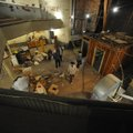 Visitors take a look around the old opera house on the second floor of the old Dixieland shoe store ...