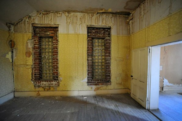 Photo by Michael Woods—                                                                                        One of the rooms in in need of restoration at the old opera house on the second floor of the old Dixieland shoe store on the corner of Walnut and 1st street in Rogers Wednesday morning.  John Mack, owner of JKJ Architects, recently purchase the former Dixieland Shoe store. He is restoring the building which includes the Opera House on the second floor, once a grand theater.