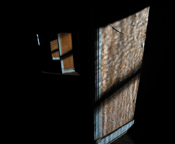 Photo by Michael Woods—                                                                                        Sunlight splashes the walls at the old opera house on the second floor of the old Dixieland shoe store on the corner of Walnut and 1st street in Rogers Wednesday morning.  John Mack, owner of JKJ Architects, recently purchase the former Dixieland Shoe store. He is restoring the building which includes the Opera House on the second floor, once a grand theater.