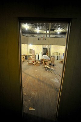Photo by Michael Woods—                                                                                        Looking into the main room at the old opera house on the second floor of the old Dixieland shoe store on the corner of Walnut and 1st street in Rogers Wednesday morning.  John Mack, owner of JKJ Architects, recently purchase the former Dixieland Shoe store. He is restoring the building which includes the Opera House on the second floor, once a grand theater.