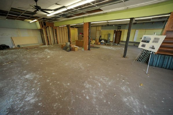 Photo by Michael Woods—                                                                                        The first floor of the old Dixieland shoe store on the corner of Walnut and 1st street in Rogers Wednesday morning.  John Mack, owner of JKJ Architects, recently purchase the former Dixieland Shoe store. He is restoring the building which includes the Opera House on the second floor, once a grand theater.
