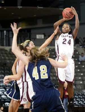 UALR guard Taylor Gault (middle) tries to drive to the basket between two Tulsa defenders during the Trojans' 78-51 victory Tuesday at the Jack Stephens Center in Little Rock.