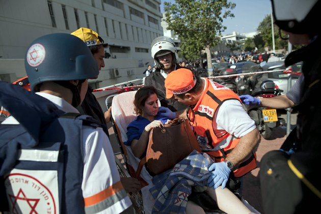 israeli-rescue-workers-and-paramedics-carry-an-injured-woman-from-the-site-of-a-bombing-in-tel-aviv-israel-on-wednesday-nov-21-2012