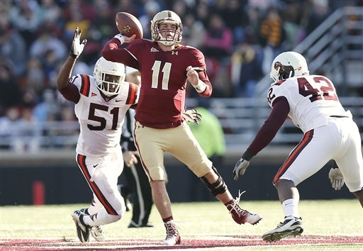 boston-college-quarterback-chase-rettig-throws-under-pressure-from-virginia-techs-bruce-taylor-51-and-jr-collins-during-the-first-half-of-a-ncaa-football-game-at-alumni-stadium-in-boston-saturday
