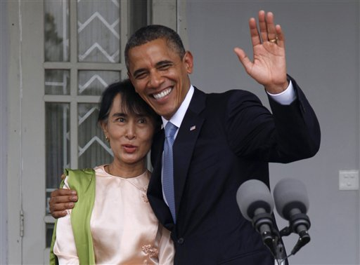 in-this-nov-19-2012-file-photo-us-president-barack-obama-waves-to-the-media-as-he-embraces-myanmar-opposition-leader-aung-san-suu-kyi-after-they-spoke-to-the-media-at-her-residence-in-yangon-myanmar-monday-the-united-states-is-unwinding-two-decades-of-sanctions-against-myanmar-as-the-countrys-reformist-leadership-oversees-rapid-fire-economic-and-political-change-obamas-visit-this-week-the-first-by-a-serving-us-president-is-a-sign-of-how-far-relations-have-come-but-washington-continues-to-take-a-calibrated-approach-to-easing-sanctions-keen-to-retain-leverage-should-myanmars-reform-momentum-stall