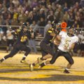 Brandon Nodier, a Prairie Grove linebacker, sacks Pottsville quarterback Michael Perry, which caused...