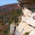 Hikers tread carefully along a narrow section of the Goat Trail. It's a 300-foot drop from the edge ...